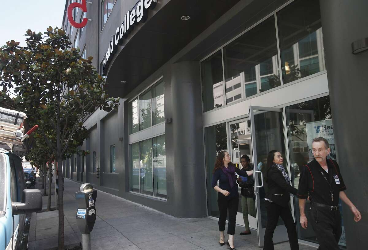 A group of people leave Heald College June 19, 2014 in San Francisco, Calif. Medical Assistant student Joseph Conner has been attending the college since January 2013 and says he has not received financial aid money since the first semester.