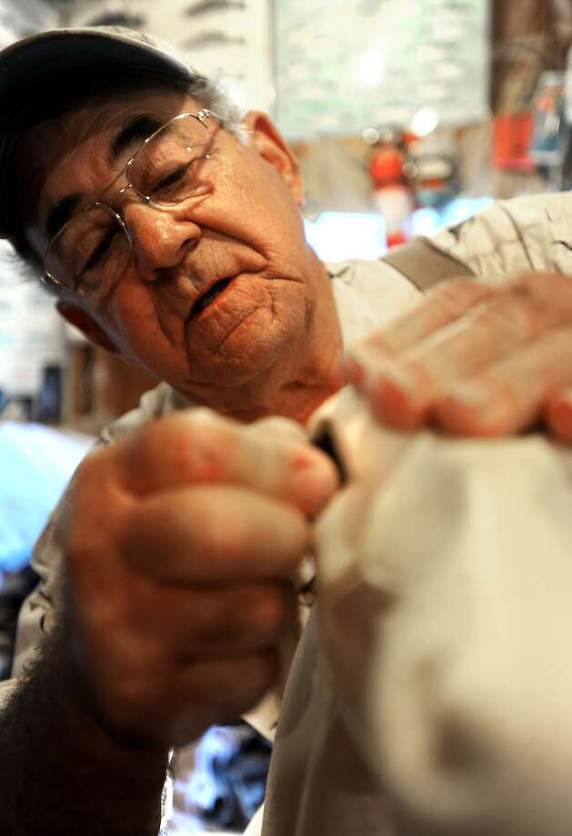 Stanley Leger demonstrates how he aligns the eyes in a deer mold at his taxidermy shop in Beaumont, Tuesday. Tammy McKinley/The Enterprise Photo: TAMMY MCKINLEY / Beaumont