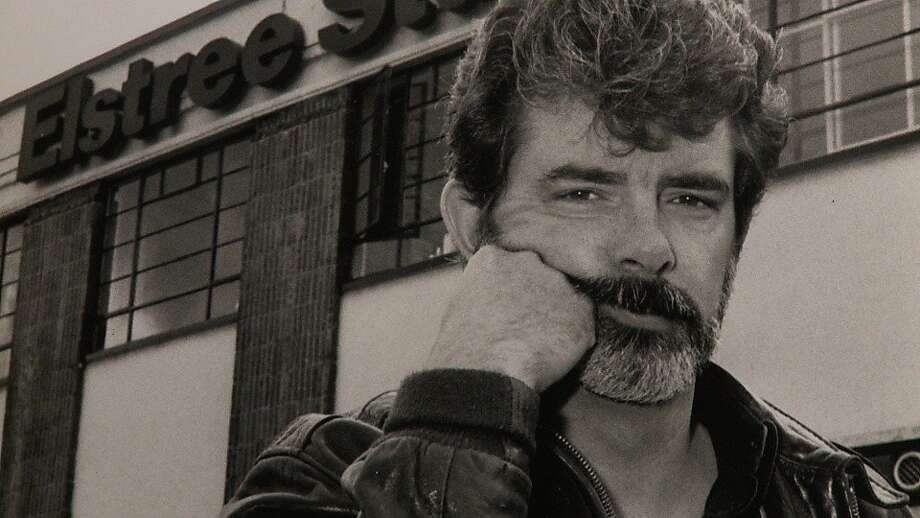 "A young George Lucas in front of Great Britain's Elstree Studios, the birthplace of ""Star Wars."" Photo: Exhibit A Pictures"