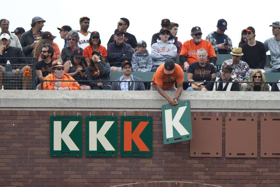 A San Francisco Giants fan turns over a K card signifying the fourth strike out by Tim Lincecum (not pictured) during the fifth inning against the San Diego Padres at AT&T Park on June 25, 2014 in San Francisco, California. Photo: Jason O. Watson, Getty Images