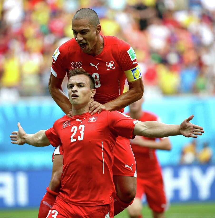 June 25Switzerland 3, Honduras 0 Photo: Felipe Dana, Associated Press / AP