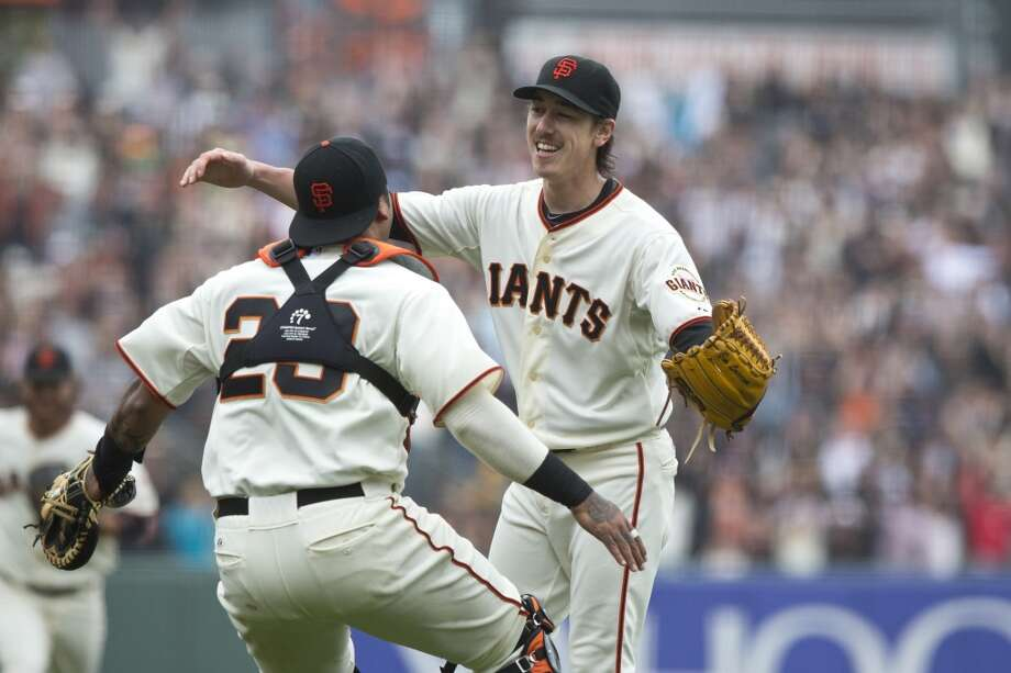 Tim Lincecum celebrates with Hector Sanchez after the game at AT&T Park on June 25, 2014 in San Francisco, California. Photo: Jason O. Watson, Getty Images