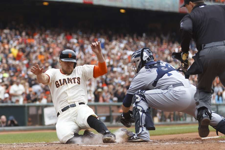 Hunter Pence slides past Rene Rivera to score a run during the seventh inning at AT&T Park on June 25, 2014 in San Francisco, California. Photo: Jason O. Watson, Getty Images