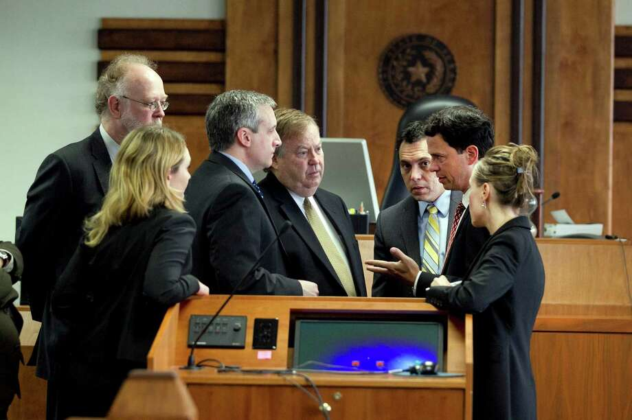 Attorneys, including Plantiff's attorneys, from second left, David Thompson, Jim Trachtenberg, Rick Gray and David Hinojosa, talk before Judge David Peeples, Friday, June 20, 2014, during a hearing on Attorney Gen. Greg Abbott's request to remove District Judge John Dietz from the long-running school finance lawsuit in Austin, Texas. (AP Photo/Austin American-Statesman, Deborah Cannon) Photo: Dborah Cannon, MBO / American-Statesman