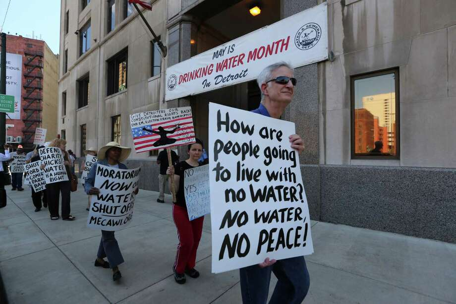 """This photo taken May 30 shows protesters with Moratorium Now! along with about 30 people rallying outside the Detroit Water Department on Randolph street against water shut-offs. The group chanted, """"Water is a human right.""""  Photo: Jessica J. Trevino, MBR / Detroit Free Press"""