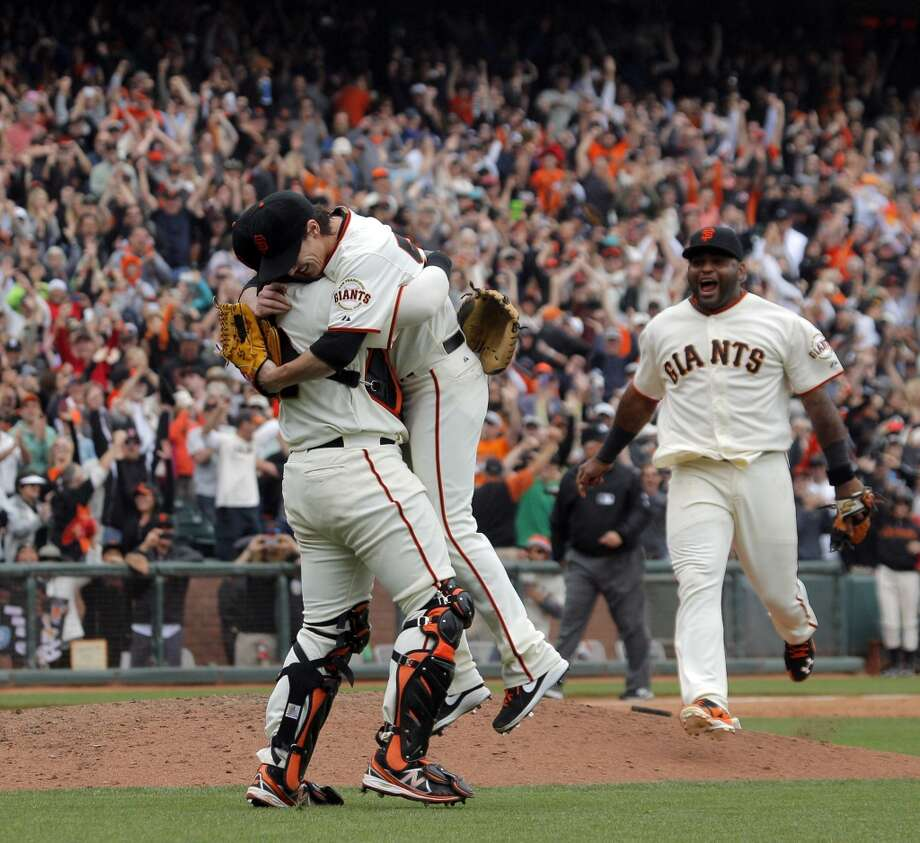 Pitcher Tim Lincecum, center, is mobbed by catcher Hector Sanchez, left, and third baseman Pablo Sandoval after he pitched a no hitter as the San Francisco Giants played the San Diego Padres at AT&T Park in San Francisco, Calif., on Wednesday, June 25, 2014, defeating the Padres 4-0. Photo: San Francisco Chronicle