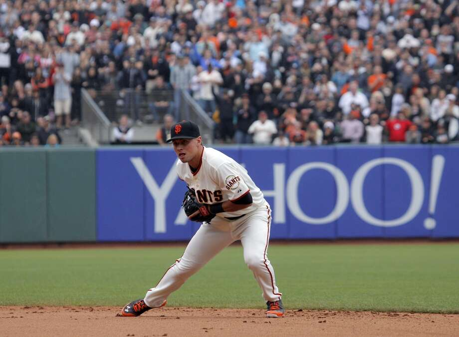 Giants second baseman Joe Panik, fields the final out as pitcher Tim Lincecum pitched a no hitter as the San Francisco Giants played the San Diego Padres at AT&T Park in San Francisco, Calif., on Wednesday, June 25, 2014, defeating the Padres 4-0. Photo: San Francisco Chronicle