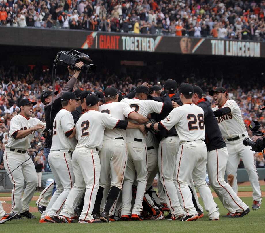 Pitcher Tim Lincecum, obscured, is mobbed by teammates after he pitched a no hitter as the San Francisco Giants played the San Diego Padres at AT&T Park in San Francisco, Calif., on Wednesday, June 25, 2014, defeating the Padres 4-0. Photo: San Francisco Chronicle