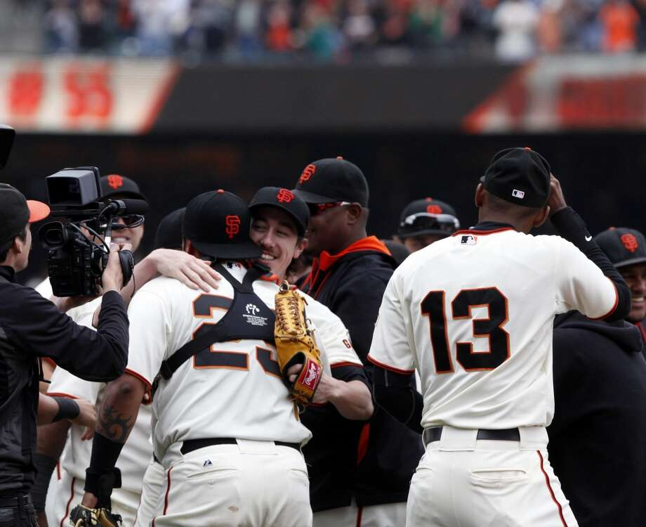 Pitcher Tim Lincecum, center, is mobbed by teammates after he pitched a no hitter as the San Francisco Giants played the San Diego Padres at AT&T Park in San Francisco, Calif., on Wednesday, June 25, 2014, defeating the Padres 4-0. Photo: San Francisco Chronicle