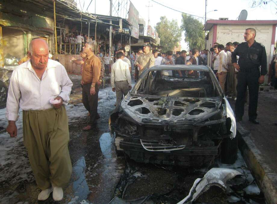 Iraqis gather at the site of a bombing in the oil rich city of Kirkuk, in northern Iraq, Wednesday, June 25, 2014. Photo: Associated Press / AP