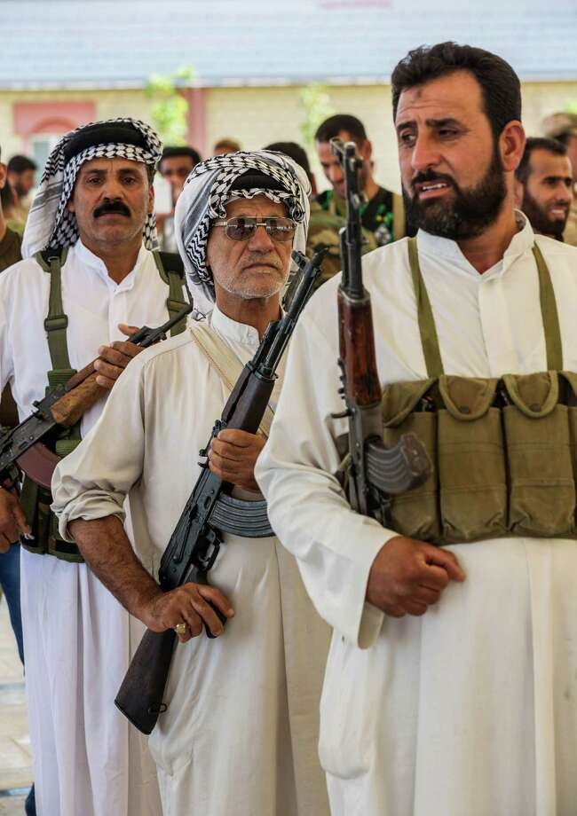 Members of an Iraqi volunteer force train in the Shiite holy city of Karbala, 50 miles (80 kilometers) south of Baghdad, Iraq, Wednesday, June 25, 2014, after authorities urged Iraqis to help battle insurgents. Photo: Ahmed Al-Husseini, Associated Press / AP