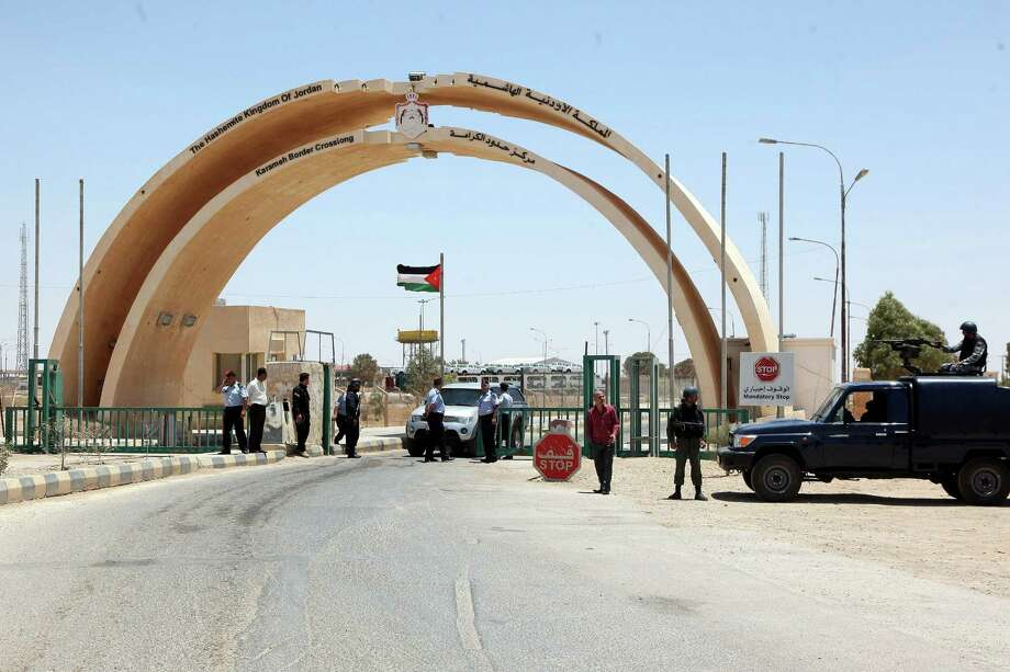 Jordanian security forces stand guard at the Al-Karameh border point with Iraq on June 25, 2014 as Jordan reinforced its border with Iraq after Sunni Arab militants overran a crossing with Syria. Photo: -, AFP/Getty Images / AFP