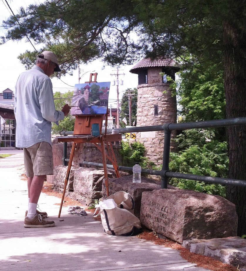 Artist Jay Babina does a painting of the Milford Memorial Bridge (also known as Stone Bridge) as part of the Milford Arts Council's Plein Air Event for the town's 375th anniversary celebration. The work is included in an art exhibit that opens Thursday, July 3, at the Parsons Complex. Photo: Contributed Photo / Connecticut Post Contributed
