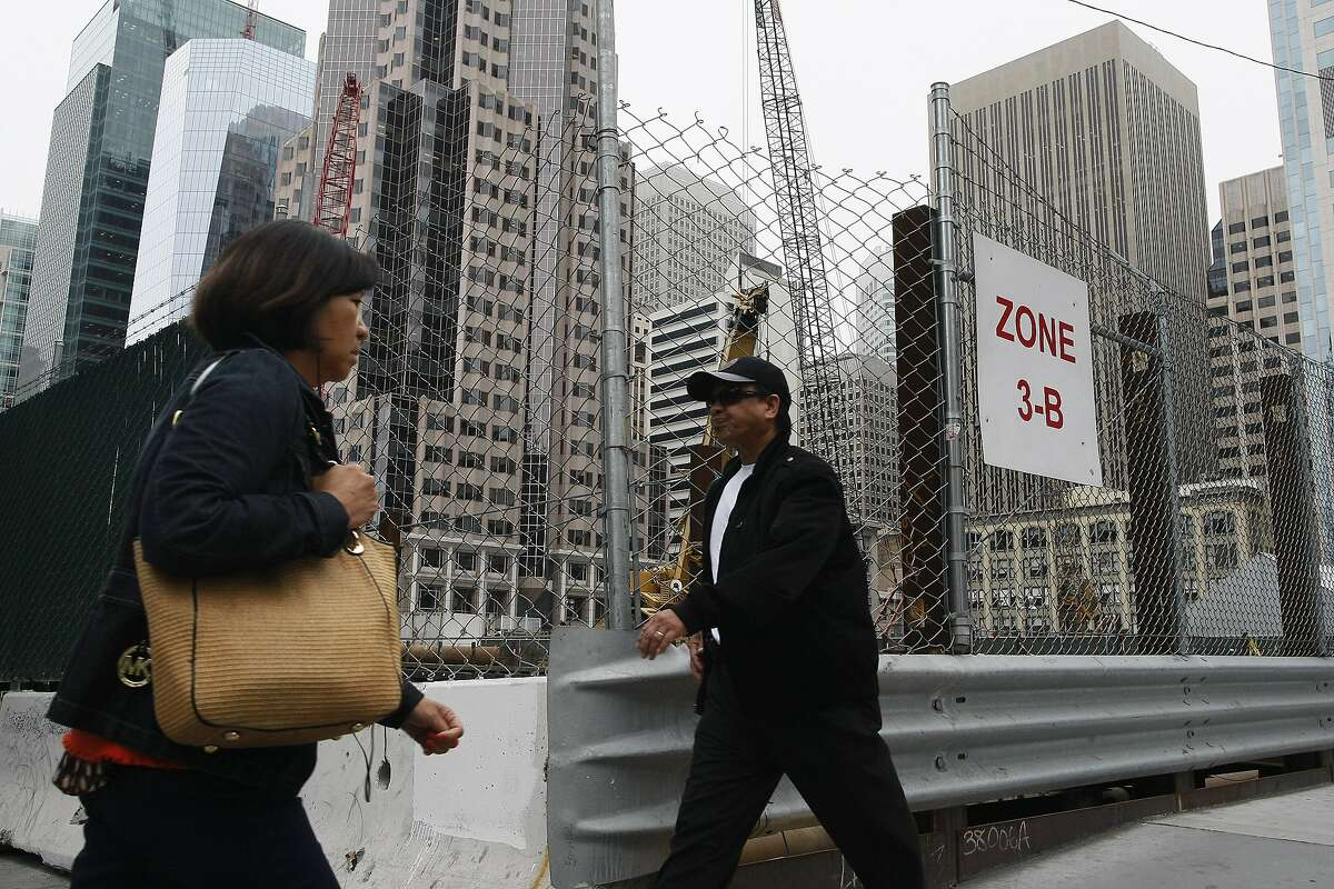 Pedestrians pass the site of the future Transbay Terminal on 415 Mission St. in San Francisco, Calif. on Wednesday, June 25, 2015, 2014. The Transbay Terminal will not be able to open with a public rooftop park without the aide of the private sector.