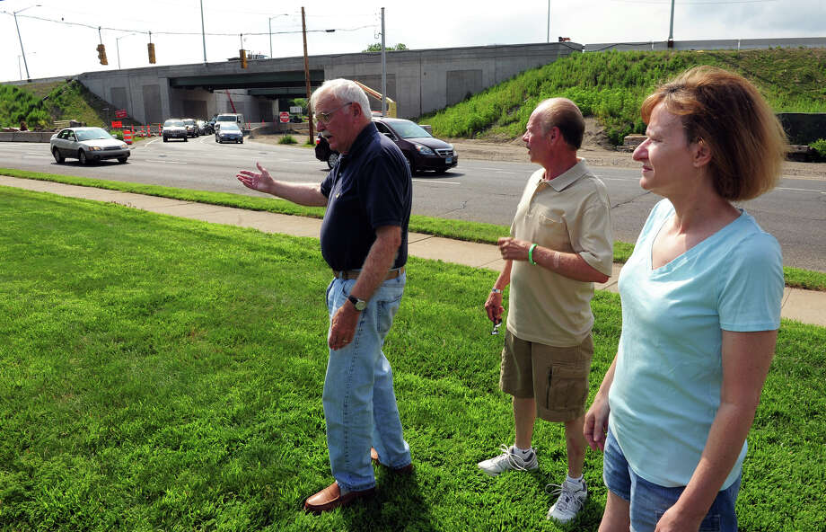 Charles Perez, President of S.A.F.E. (Stratford Action for the Environment), center left, talks about the environmental impact of the proposed plans to expand exit 33 off of I95 at Ferry Boulavard in Stratford, Conn. on Wednesday June 25, 2014. Next to Perez is S.A.F.E.'s Vice President Ron Mazzey and S.A.F.E. member Barbara Dugan. Photo: Christian Abraham / Connecticut Post