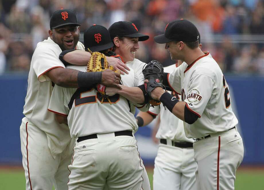 San Francisco Giants pitcher Tim Lincecum, center, is embraced by teammates, from left, Pablo Sandoval, catcher Hector Sanchez, and Buster Posey after throwing a no-hitter against the San Diego Padres a baseball game Wednesday, June 25, 2014, in San Francisco. Lincecum threw his second career no-hitter as San Francisco won 4-0. (AP Photo/Eric Risberg) ORG XMIT: FXPB111 Photo: Eric Risberg / AP