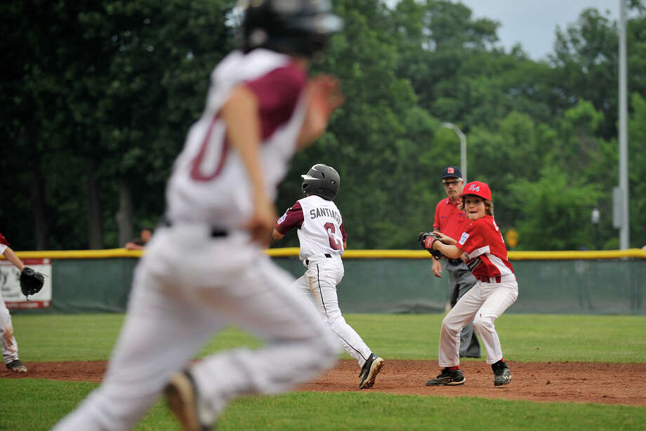 Scenes from the Stamford National versus Stamford American baseball game at Scalzi Park in Stamford, Conn., on Wednesday, June 25, 2014. The Stamford National team won 14-2 in four innings. Photo: Jason Rearick / Stamford Advocate