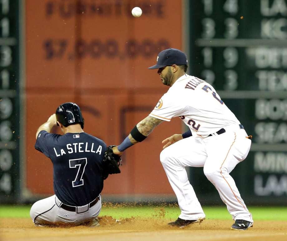 Atlanta Braves' Tommy La Stella (7) steals second base as Houston Astros shortstop Jonathan Villar (2) tags him before realizing he lost the ball in the fourth inning of a baseball game, Wednesday, June 25, 2014, in Houston. (AP Photo/Pat Sullivan) Photo: Pat Sullivan, Associated Press / AP