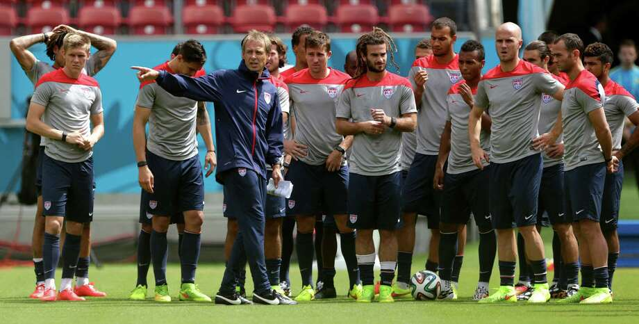 United States' head coach Jurgen Klinsmann, center left, instructs his players during a training session in Recife, Brazil, Wednesday, June 25, 2014. The U.S. will play Germany in group G of the 2014 soccer World Cup on June 26. (AP Photo/Julio Cortez) ORG XMIT: BRAJC108 Photo: Julio Cortez / AP