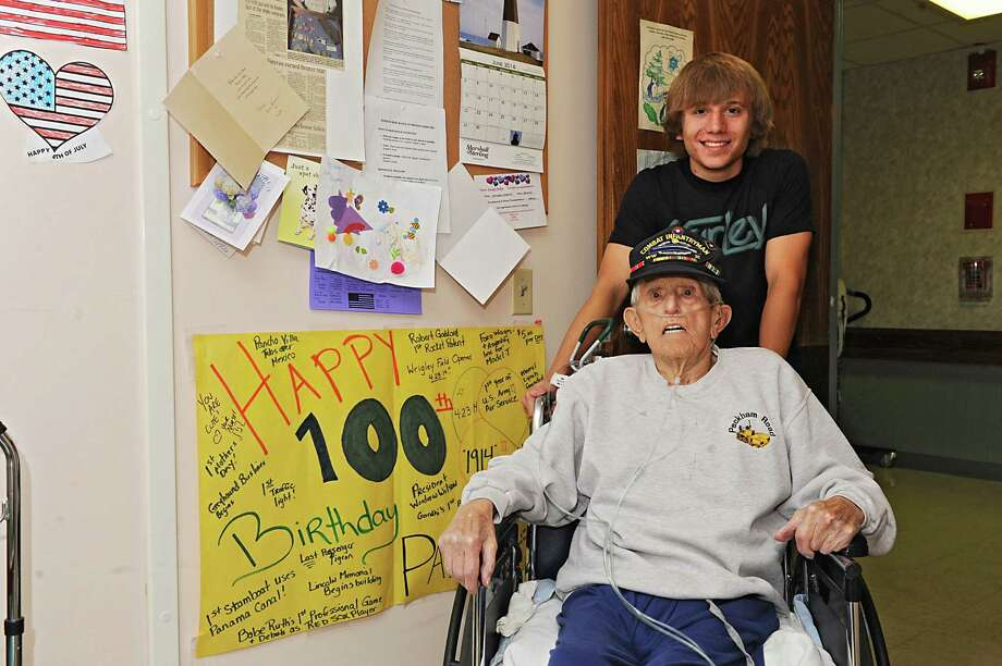 Devin Stark, 19, smiles for a photo with his 100-yr-old great- grandfather George Hulka at the Wesley Community Center on Tuesday, June 24, 2014 in Saratoga Springs, N.Y. George never graduated from high school because he left for World War II, but will graduate this week at Schuylerville with his great-grandson, Devin. (Lori Van Buren / Times Union) Photo: Lori Van Buren / 00027480A