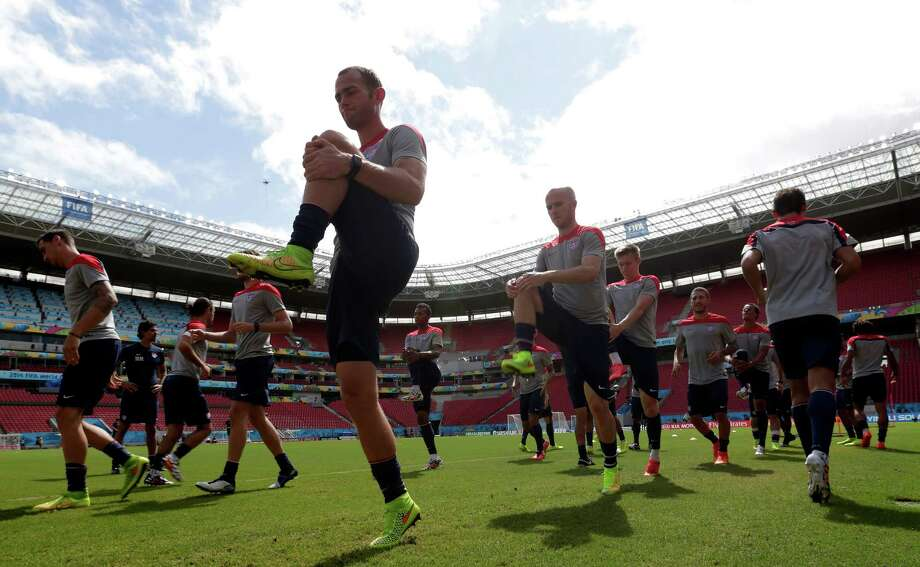Brad Davis, front, and Michael Bradley are among the U.S. players going through their final workout at the stadium in Recife, Brazil, where the Americans will meet Germany today. Photo: Julio Cortez, STF / AP