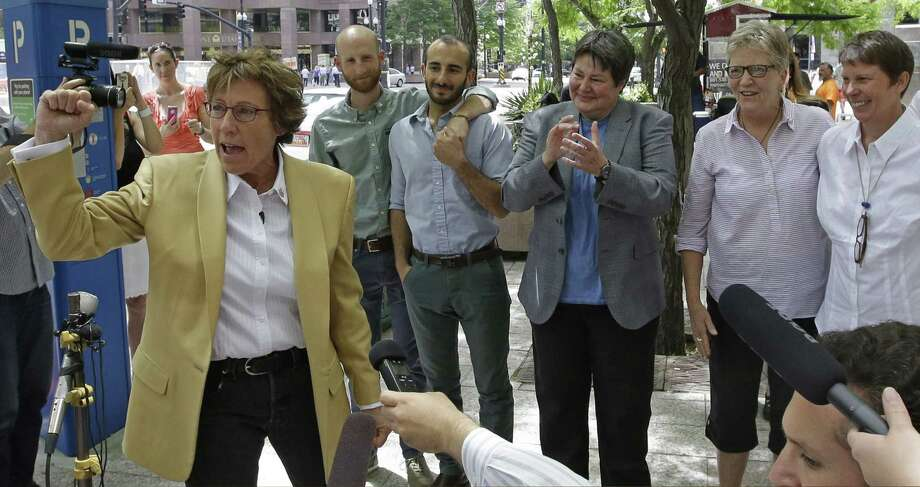 Peggy Tomsic (left), attorney for the plaintiffs,  speaks on the ruling that said states must allow gay couples to marry. Photo: Rick Bowmer / Associated Press / AP