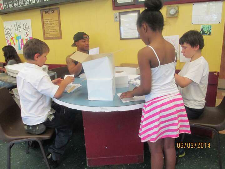 Lansingburgh Boys & Girls Club members help in a general appeal mailing sent out to about 20,000 hou