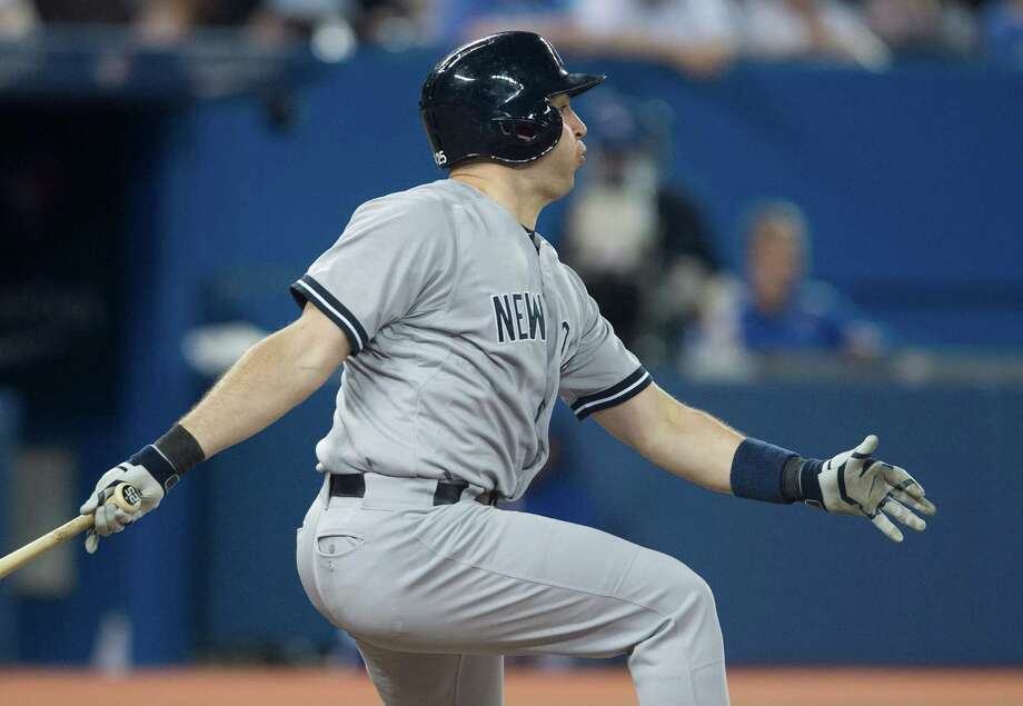 New York Yankees' Mark Teixeira knocks in the tying runs after hitting safely on a throwing error by Toronto Blue Jays' Jose Reyes in the seventh inning of MLB baseball action in Toronto on Tuesday, June 24, 2014. (AP Photo/The Canadian Press, Darren Calabrese) ORG XMIT: DBC123 Photo: Darren Calabrese / The Canadian Press