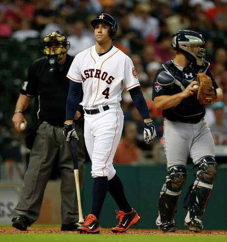 George Springer contributes to the Astros' flailing offense with a strikeout in the fourth inning. Photo: Karen Warren, Staff / © 2014 Houston Chronicle