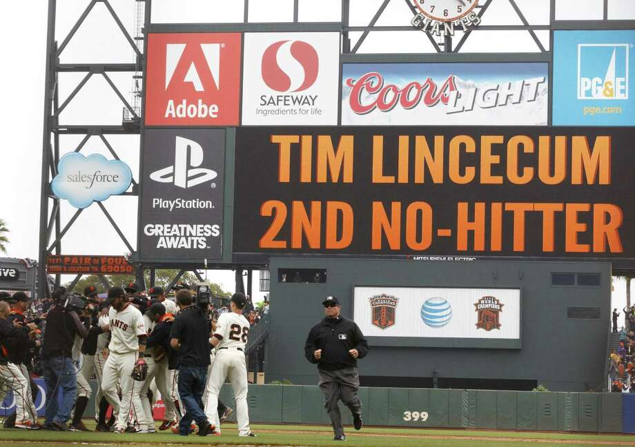 Giants players mob Tim Lincecum (obscured) after his no-hitter against the Padres in San Francisco, repeating the feat he accomplished last July 13. Photo: Jason O. Watson / Getty Images / 2014 Getty Images