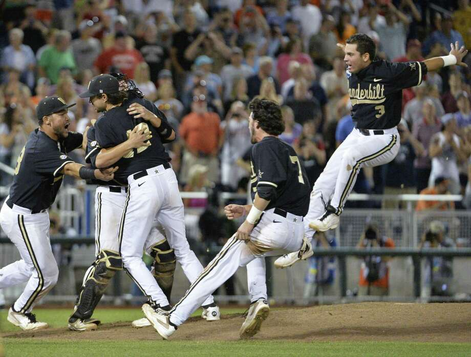 Vanderbilt players celebrate their victory over Virginia in the deciding game of the College World Series. The Commodores' championship is the first for the school in a men's sport. Photo: Ted Kirk / Associated Press / FR34398 AP
