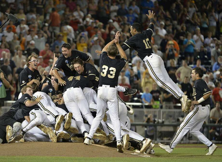 Vanderbilt players celebrate on the mound after winning the school's first-ever College World Series title. Photo: Ted Kirk, Associated Press