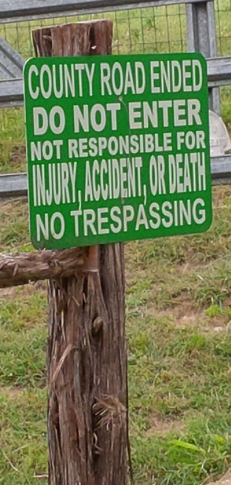 Kendall County authorities removed signs like this one that had recently been erected along Upper Cibolo Creek Road, which is claimed as a county road. Photo: Courtesy Photo