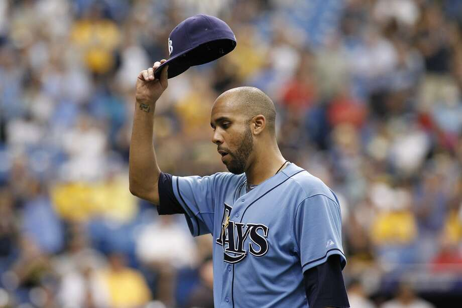 ST. PETERSBURG, FL - JUNE 25:  Pitcher David Price #14 of the Tampa Bay Rays lifts his hat to the crowd as he comes off the mound after giving up a solo home run to Andrew McCutchen #22 of the Pittsburgh Pirates during the ninth inning of a game on June 25, 2014 at Tropicana Field in St. Petersburg, Florida.  (Photo by Brian Blanco/Getty Images) Photo: Brian Blanco, Getty Images