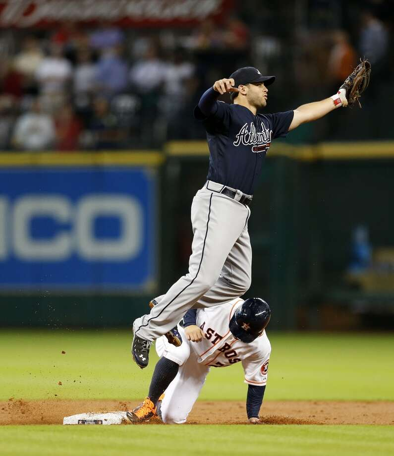 Jose Altuve steals second as Atlanta Braves second baseman Tommy La Stella tries to avoid his slide during the first inning. Photo: Karen Warren, Houston Chronicle