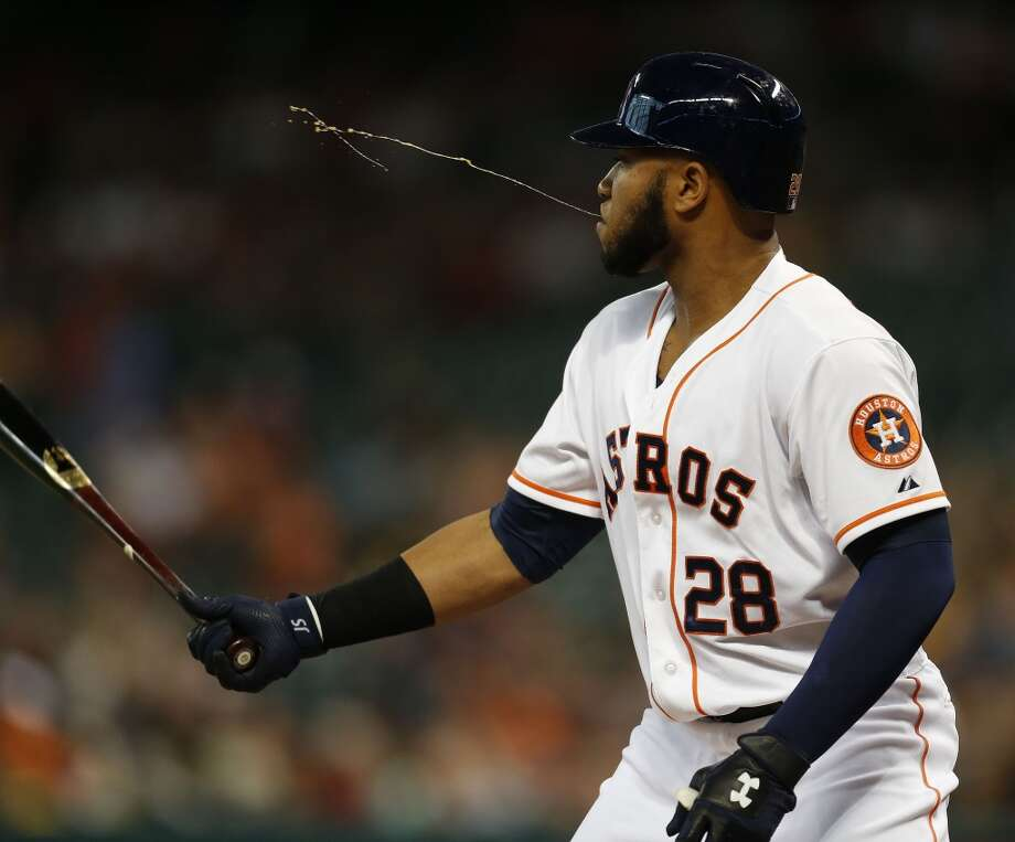 Jon Singleton spits while at bat during the first inning. Photo: Karen Warren, Houston Chronicle