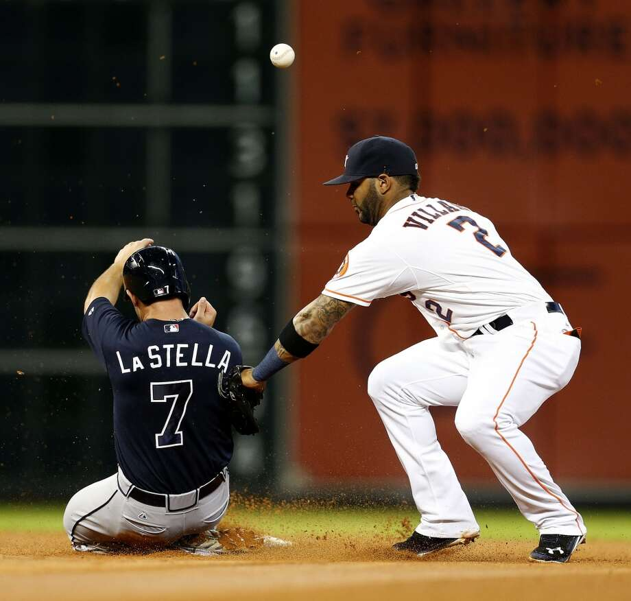 Astros shortstop Jonathan Villar bobbles the ball as Tommy La Stella (7) steals second base during the fourth inning. Photo: Karen Warren, Houston Chronicle