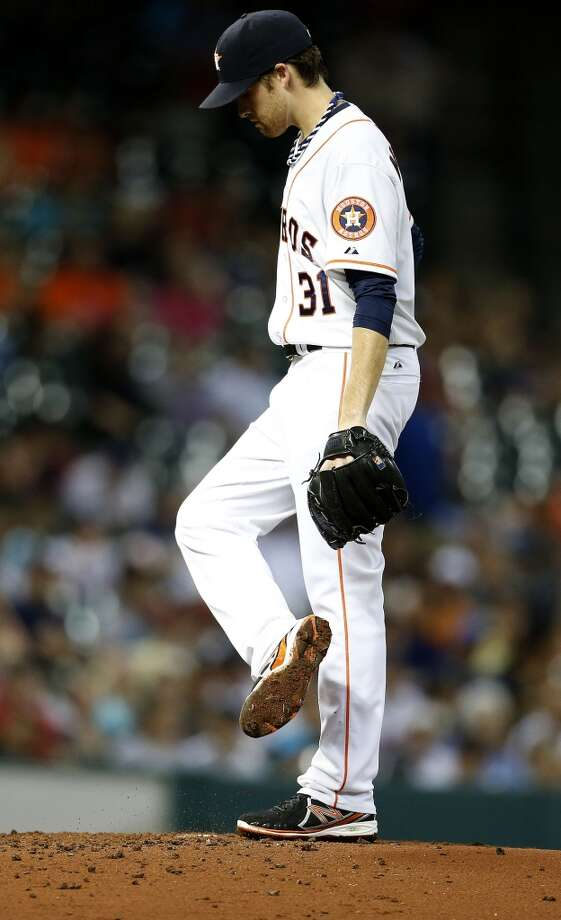 Collin McHugh reacts after giving up a walk during the fourth inning. Photo: Karen Warren, Houston Chronicle