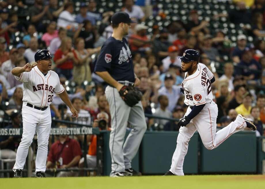on Singleton (28) runs around third base on his ground-rule double during the fourth inning. Photo: Karen Warren, Houston Chronicle