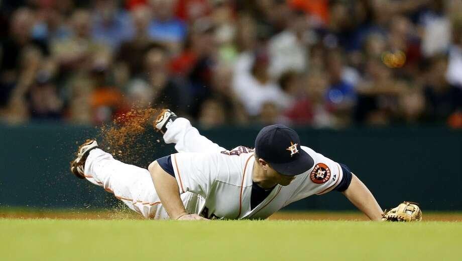 Astros third baseman Matt Dominguez dives for a ground ball during the fifth inning. Photo: Karen Warren, Houston Chronicle