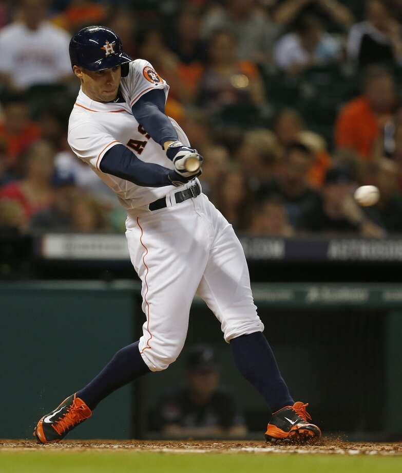 George Springer (4) hits a single during the sixth inning. Photo: Karen Warren, Houston Chronicle