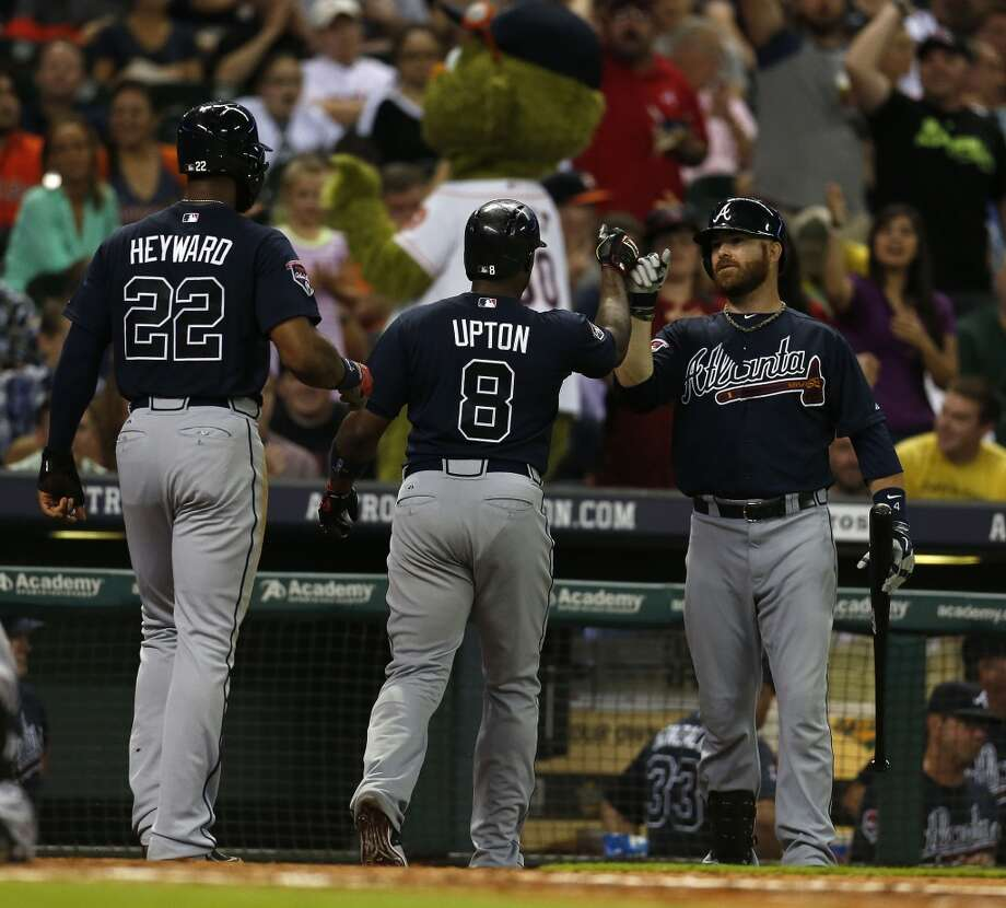 Justin Upton (8) celebrates his two-run home run during the seventh inning. Photo: Karen Warren, Houston Chronicle