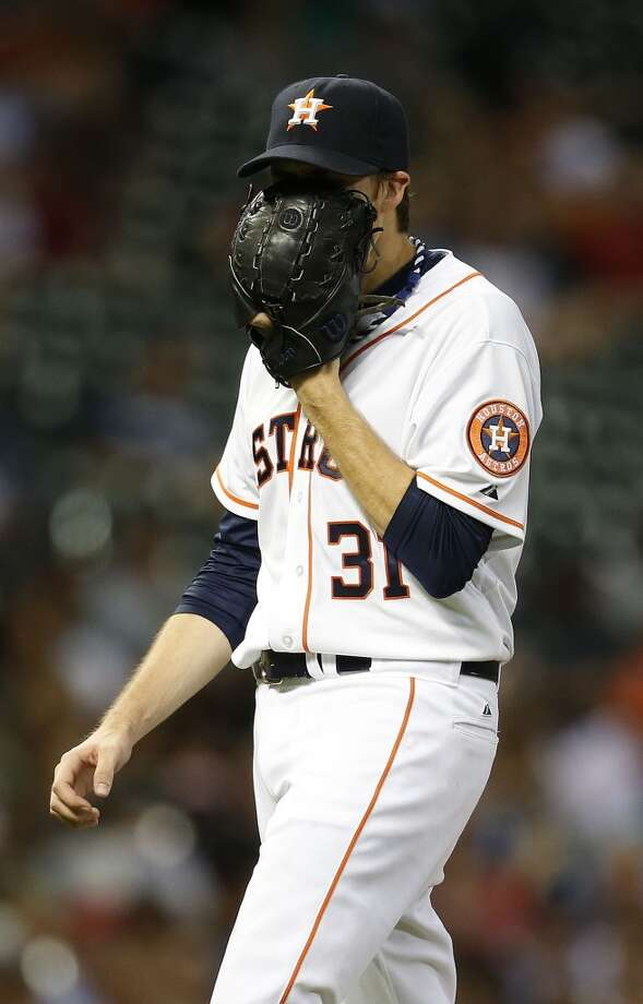 Collin McHugh (31) reacts as he walks back to the dugout in during the seventh inning. Photo: Karen Warren, Houston Chronicle