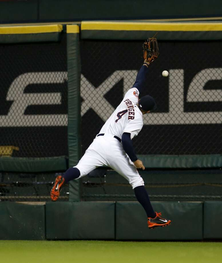 Astros right fielder George Springer (4) reaches up for a double during the eighth inning. Photo: Karen Warren, Houston Chronicle