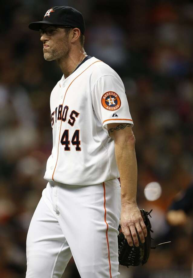 Astros relief pitcher Kyle Farnsworth (44) walks back to the dugout after getting pulled during the eighth inning. Photo: Karen Warren, Houston Chronicle