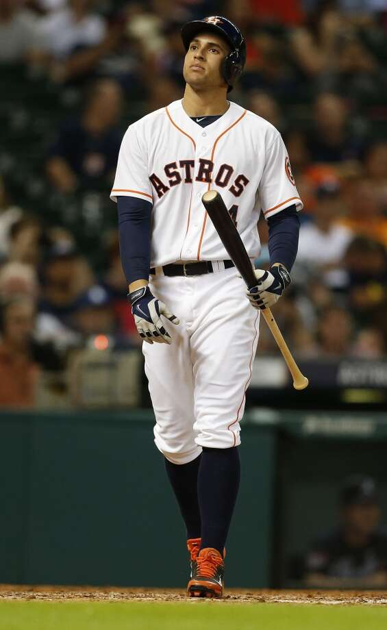 George Springer (4) reacts after striking out during the ninth inning. Photo: Karen Warren, Houston Chronicle