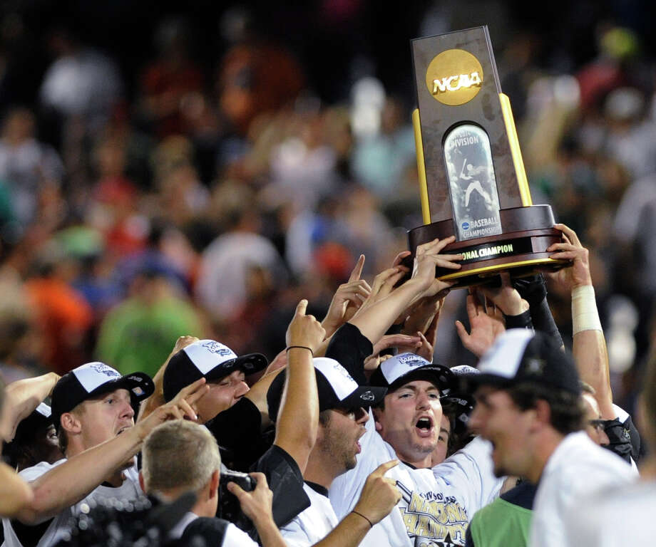 Vanderbilt players celebrate after Vanderbilt defeated Virginia 3-2 in Game 3 of the best-of-three NCAA baseball College World Series finals in Omaha, Neb., Wednesday, June 25, 2014. (AP Photo/Eric Francis) Photo: Eric Francis, Associated Press / FR9944 AP