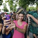 "Mckenzie Tygret (13) takes a selfie with an alligator on her head at Keewaydin Park in Kennewick, Wash., on June 25, 2014. Scott Petersen, the ""Reptile Man,"" showed off a variety of reptiles during a presentation hosted by the Mid-Columbia Libraries. (Matt Gade/Tri-City Herald/MCT)"