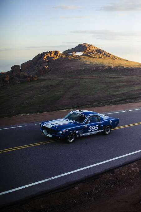 Gerie B. Bledsoe drives towards the course's first turn on the upper section in his 1966 Ford Shelby Mustang during the Pike's Peak International Hill Climb practice in Cascade, Colo. near Devil's Playground Wednesday, June 25, 2014. (AP Photo/The Colorado Springs Gazette, Julia Moss) Photo: Julia Moss, Associated Press