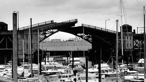 Then ÑThe 16th Avenue South Bridge is shown in Seattle's South Park neighborhood in this August 17, 1988 photo by Phil H. Webber.